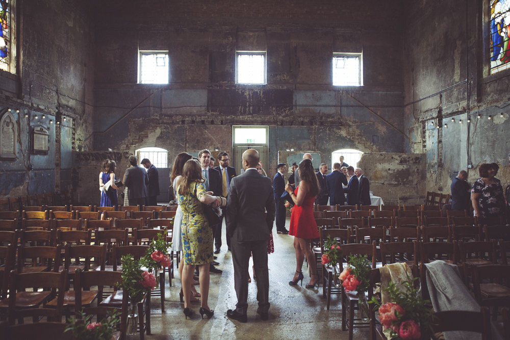 wedding guests arrive at the chapel