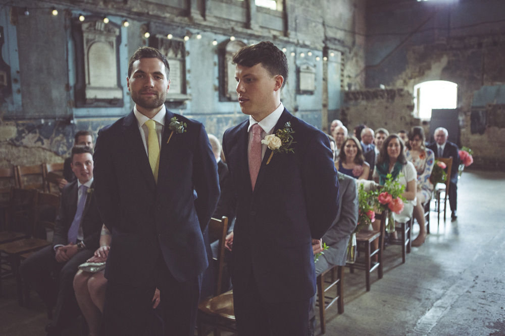 Nervous groom awaits the entrance of the bride