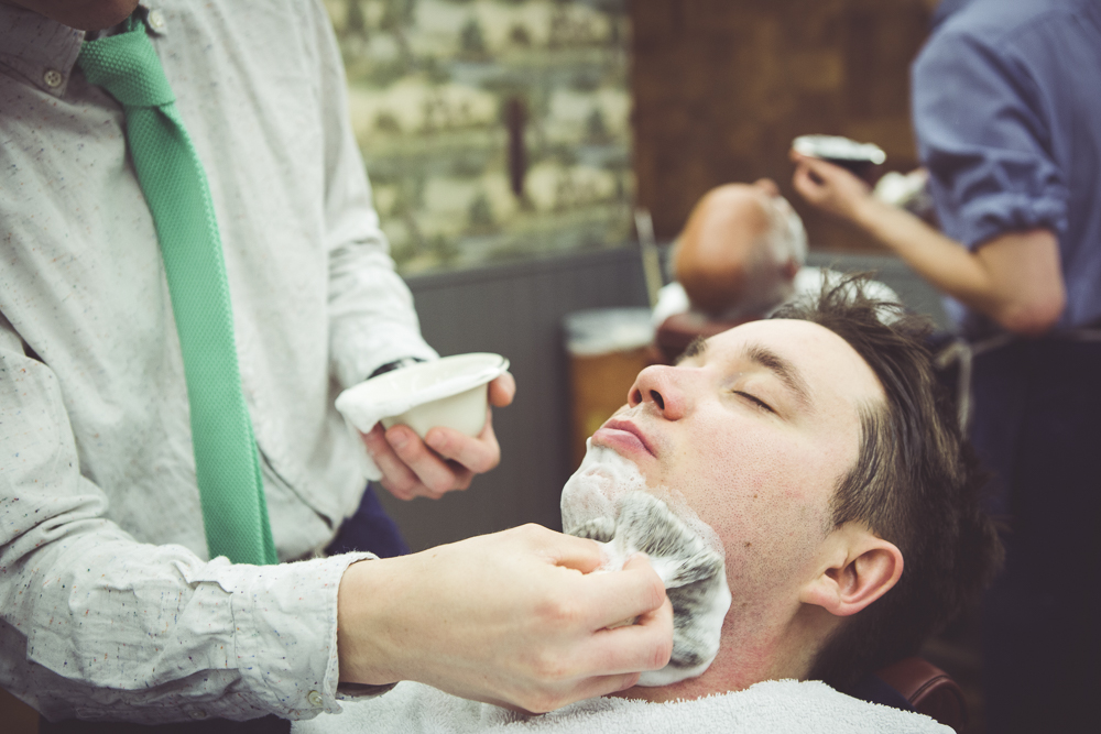 Groom having a shave