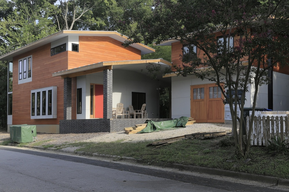 The design for 516 Euclid St is a contemporary interpretation of craftsman homes from the turn of the century through the 1930's. The emphasis on simple building forms, honest expression of locally sourced materials and exposed building details is well suited to a contemporary home in an historic district. Quite unlike the bold compositions of glass and steel seen in designs firmly rooted in the International Style of the early twentieth century, the Euclid St design uses familiar historic design elements in a manner clearly of the present tense.