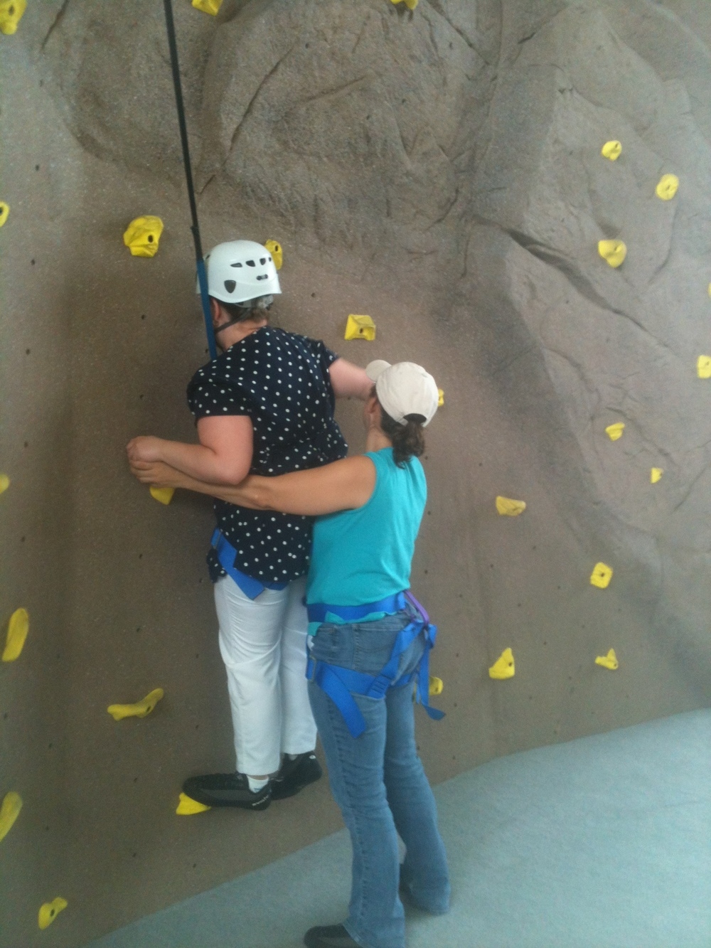 Mariya (STEP student) and Danielle (Counselor) climb the rock wall at the LaTech Gym.