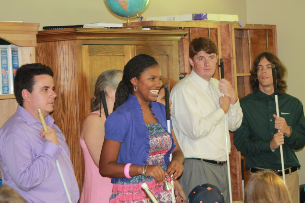 Jayla rings her freedom bell at the 2013 STEP graduation.