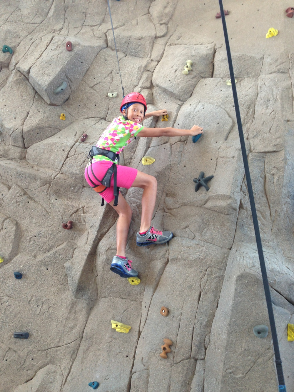Kiona climbs the rock wall at LATech