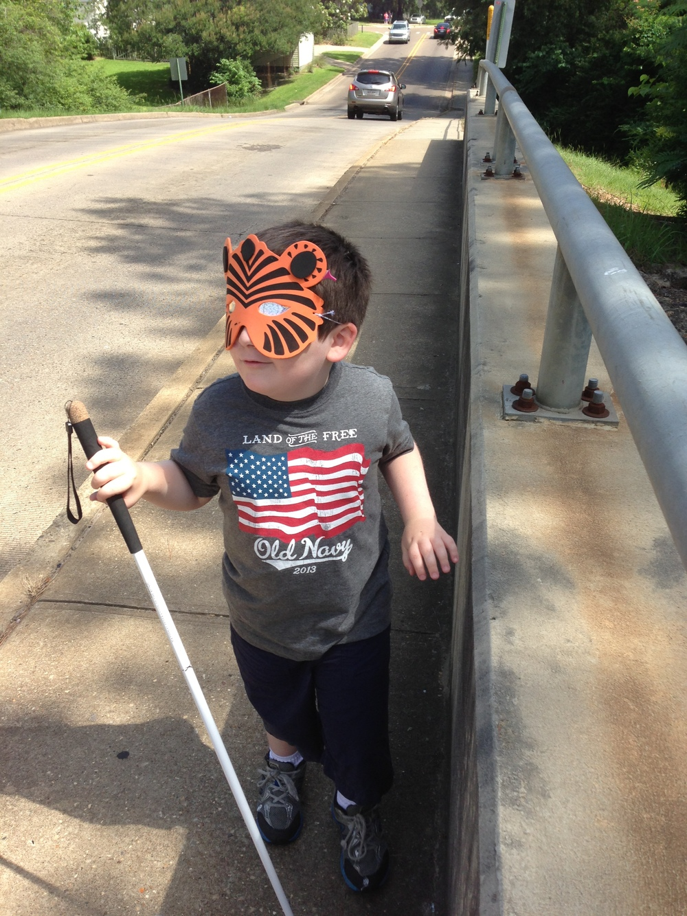 Strider uses his cane while traveling on the Farmerville bridge