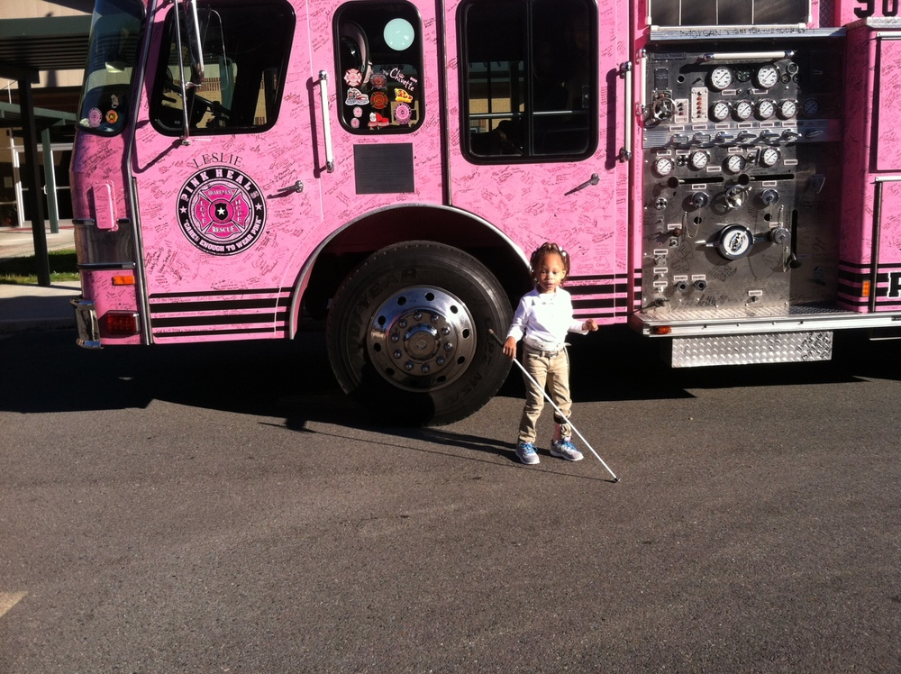Passion in front of the Pink Heals fire truck;