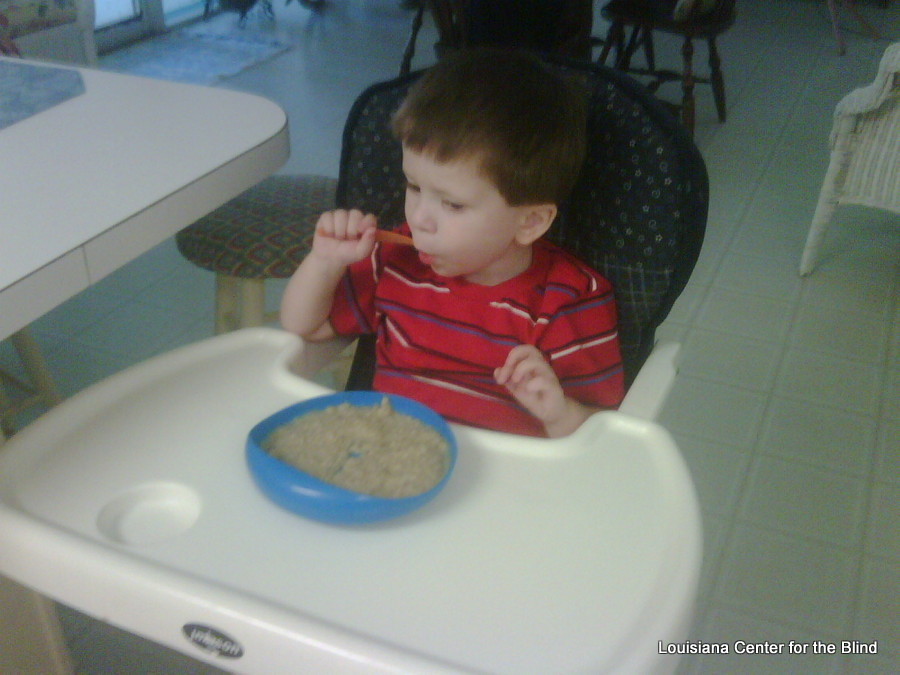 Jordan feeds himself with a SPOON!