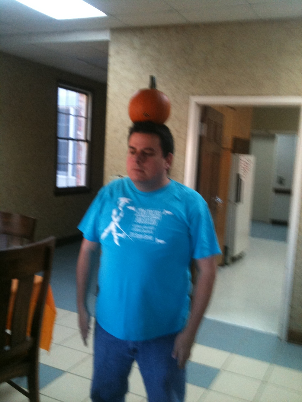 Mr. G balances a pumpkin on his head at  a fall-themed Saturday Club