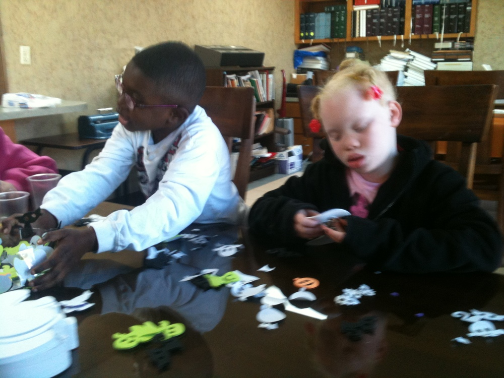 Braylon and Rekendra make some spooky crafts