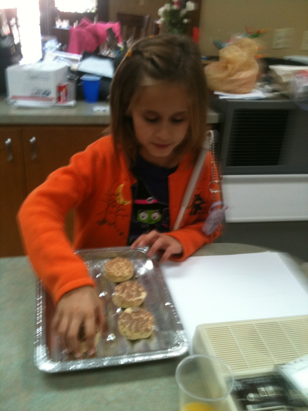 Lindsay lines up her cinnamon buns like a braille cell!