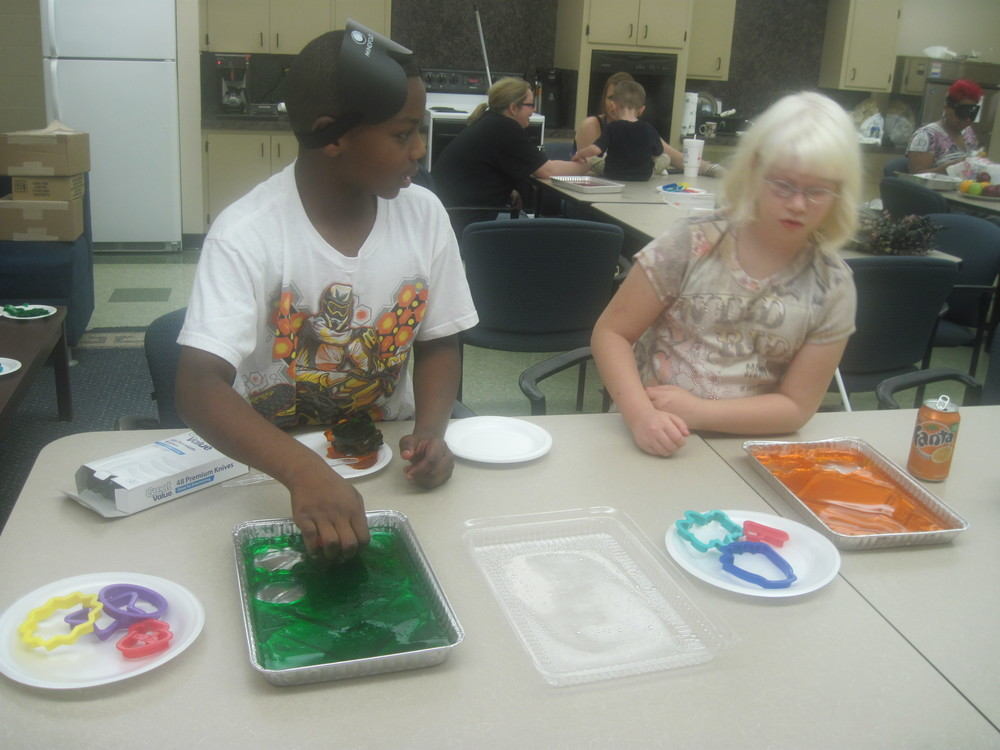 Terrell and M'Kayla cut out some spring-themes Jello jigglers