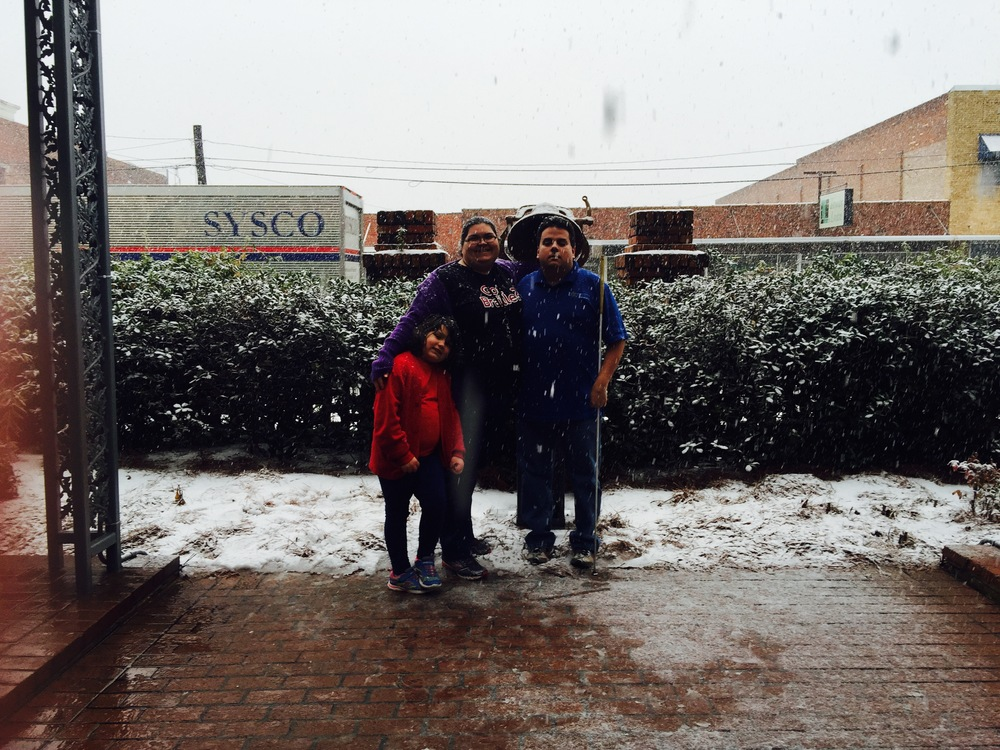 Eric, Kystal, and Bri pose for a picture in the snow