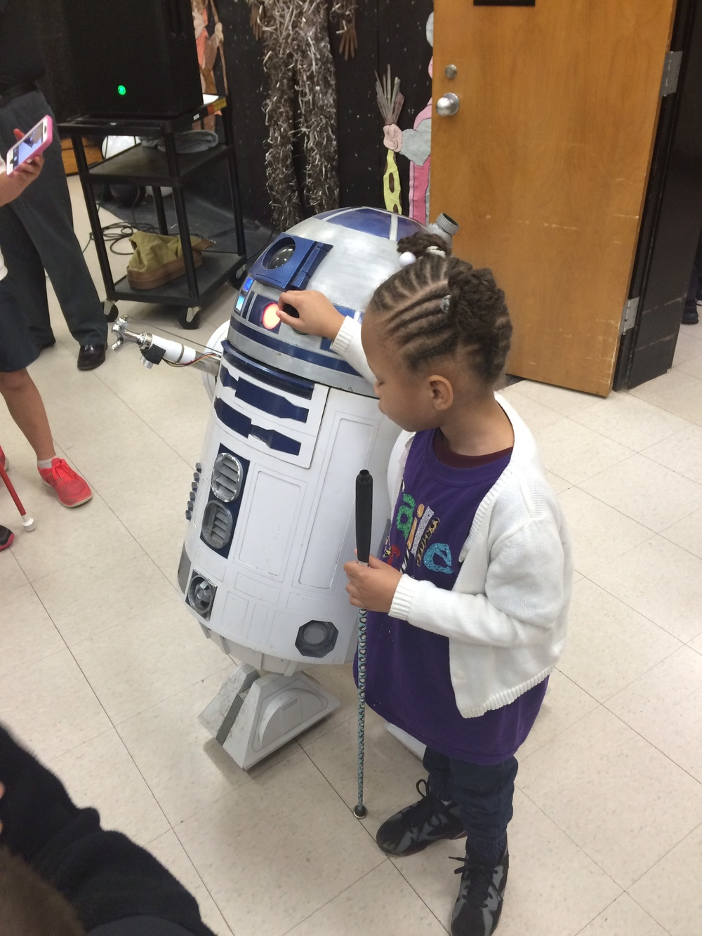 Passion checking out R2D2 at Braille Challenge