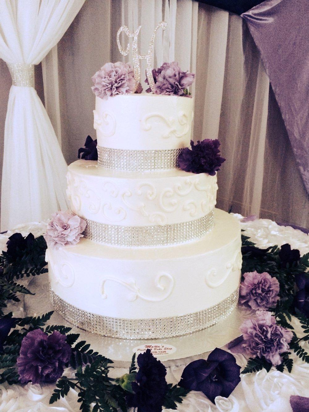 White Wedding Cake Purple Flowers.jpg