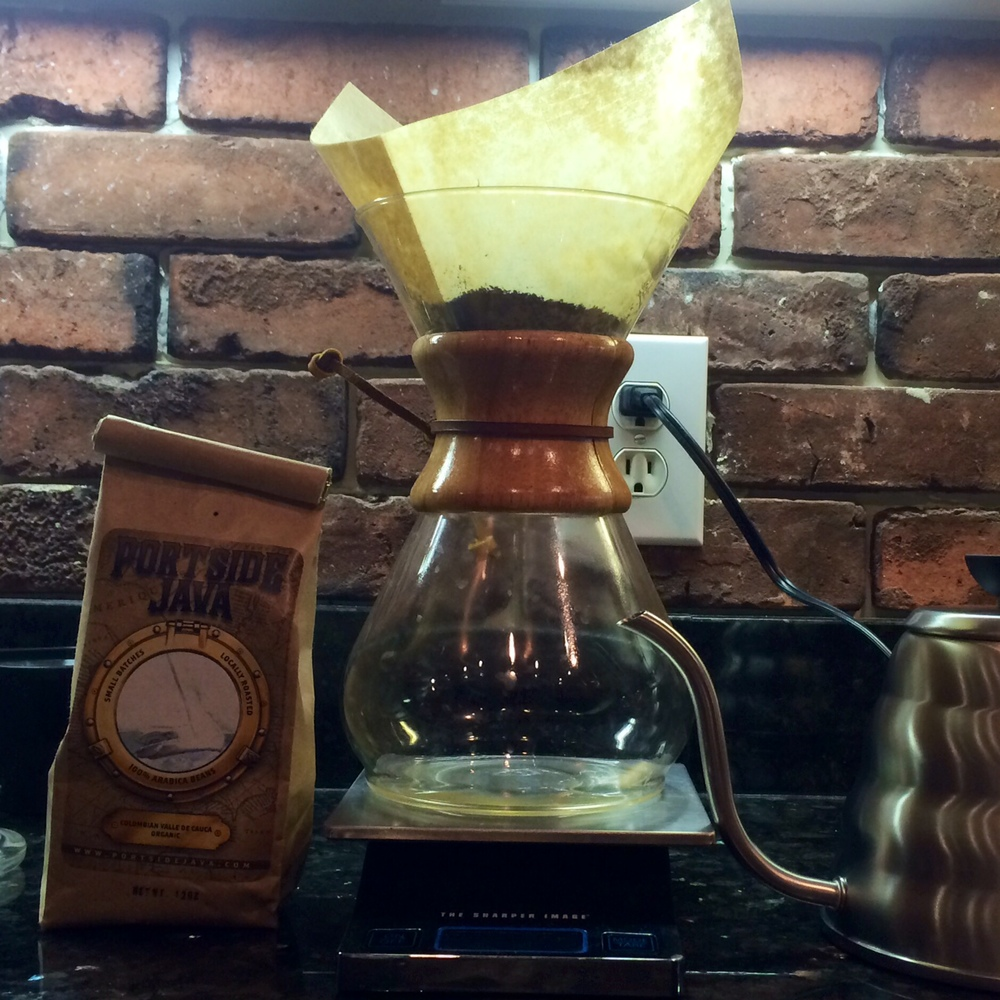 A simple home brewing setup using a Chemex pour-over coffee pot, a cheap-o digital kitchen scale (optional), a goose-neck kettle and, of course, Portside Java'a organic Colombian beans.
