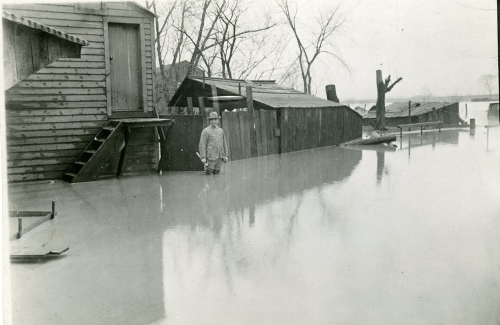 "Flooded lands along the Mt. Morris ""flats"" looking East from the village, 1916. (person unknown).       Courtesy of the Office of the Livingston County Historian"