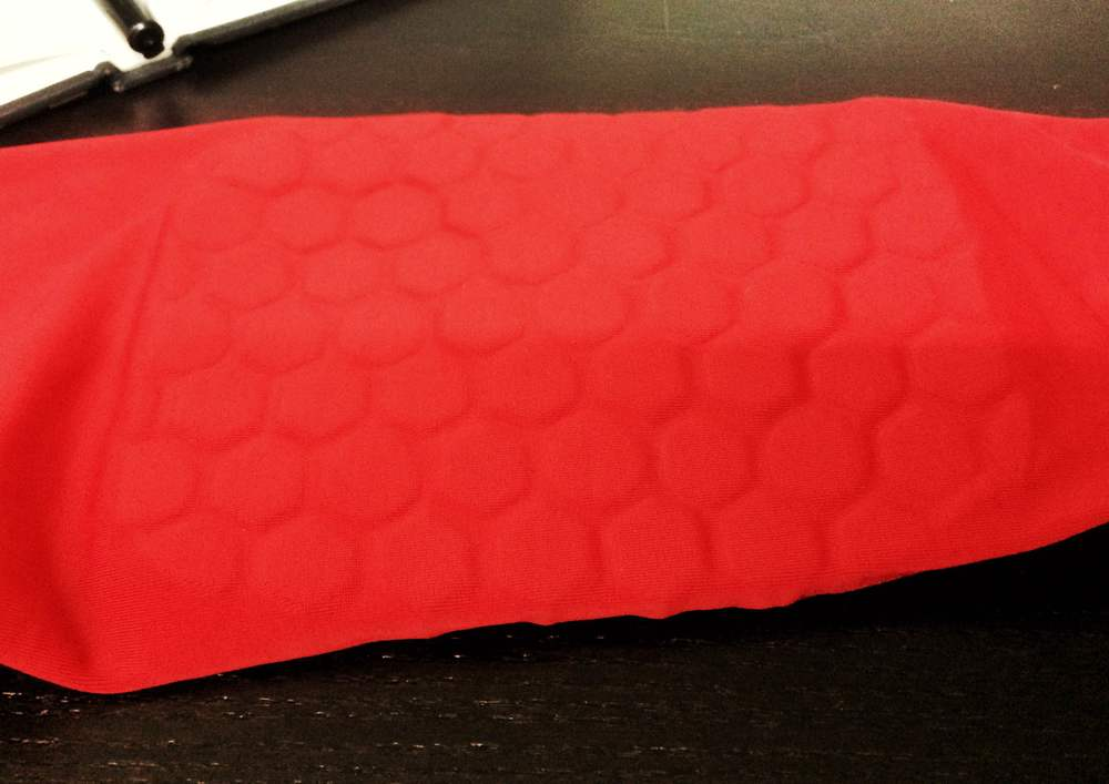 A basketball shooting sleeve with thick pieces of encapsulated Ariaprene.