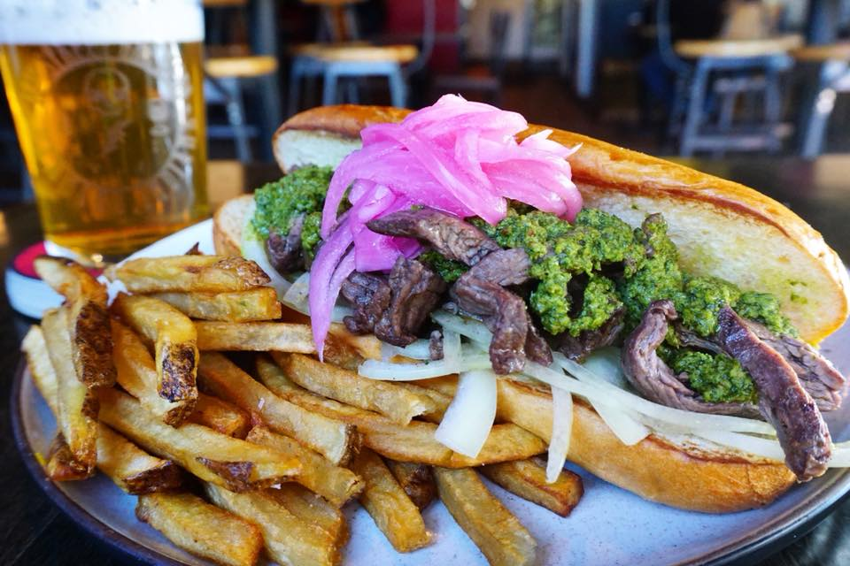 'Steak Sandwhich': This marinated steak comes served with white onions, pickled red onions and chimichurri on a toasted wheat bun with a side of handcut fries.