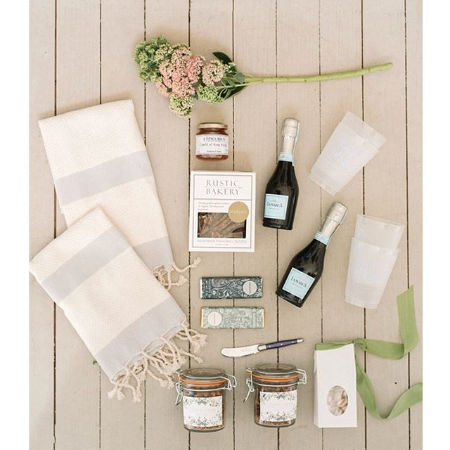 We're reliving all the pretty details from @lindsey.boyce & Mark's daytime Mount Pleasant wedding over on the @southernweddings blog - don't miss the sweetest  welcome baskets filled with goodies including the yummiest locally baked granola in weck jars & gourmet Charleston chocolate bars 🍫 | photo @seanmoney_elizabethfay planning: @acharlestonbride calligrapher and stationery: @sweetmagnoliapaper venue: @posthousemtp floral design: @outofthegarden