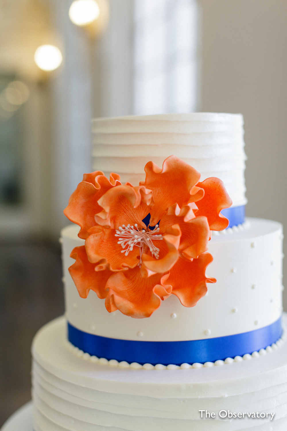 orange-flower-blue-ribbon-wedding-cake-washington-dc