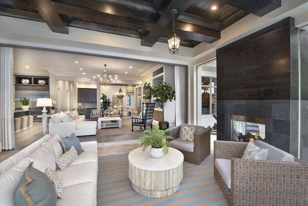 Astoria exteriors fireplace into living room  Beasley and Henley Interior Design.jpg
