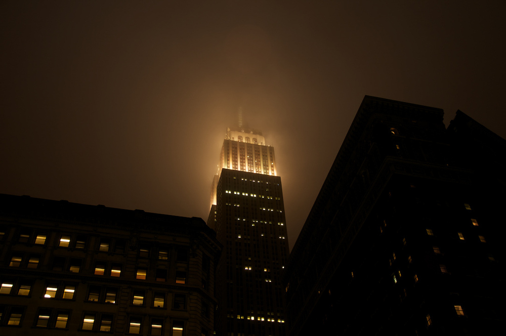 lighthouse empire state mind nyc new york city manhattan downtown fog night life light spooky mood.jpg