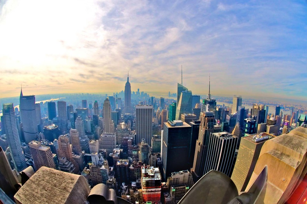 NYC view top of the rock skyline dusk cloud sun sunny new york city manhattan downtown color architecture building empire state chrysler financial district world trade one.jpg