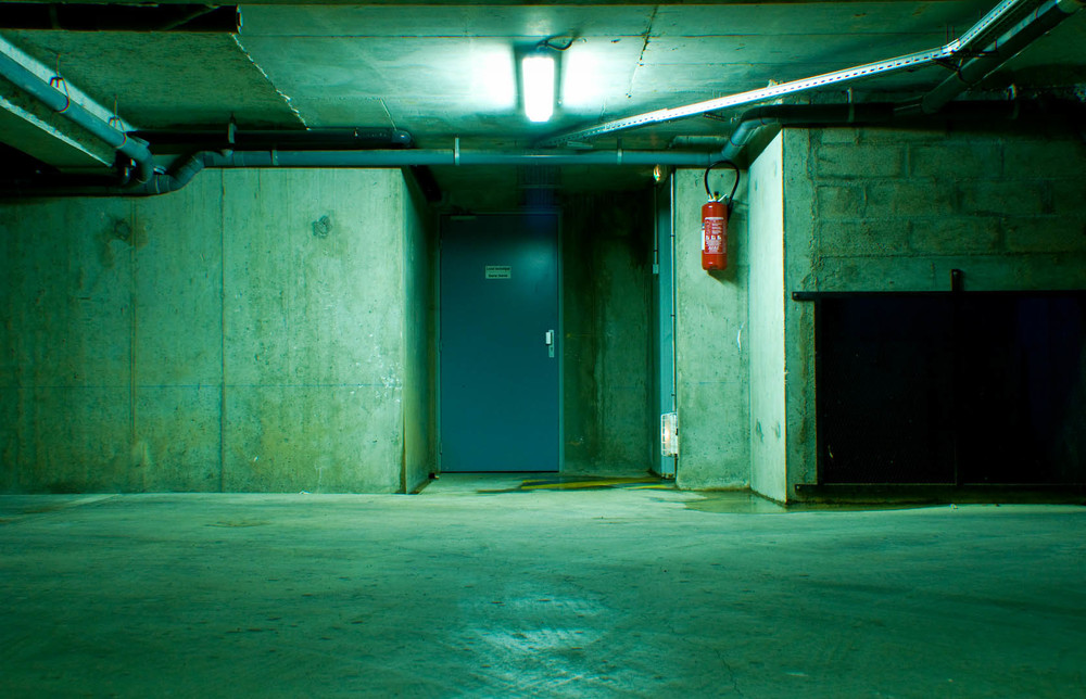 Parking lot underground france car green spooky mood oppressed scary fire extinguisher exit emergency.jpg