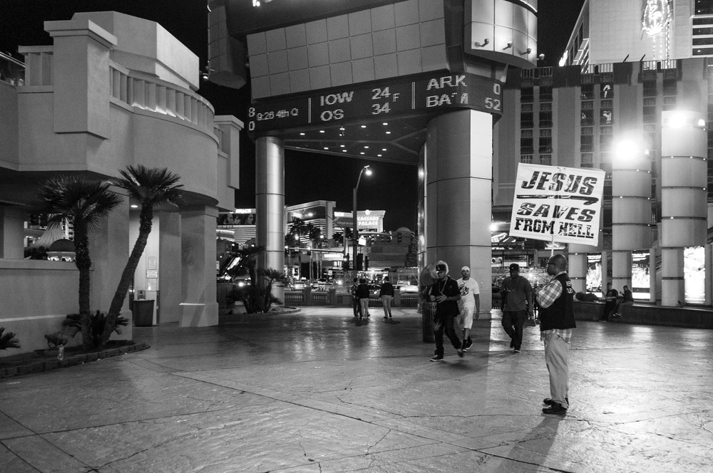 sin city jesus saves from hell b&w black white las vegas strip religion religious message messenger.jpg