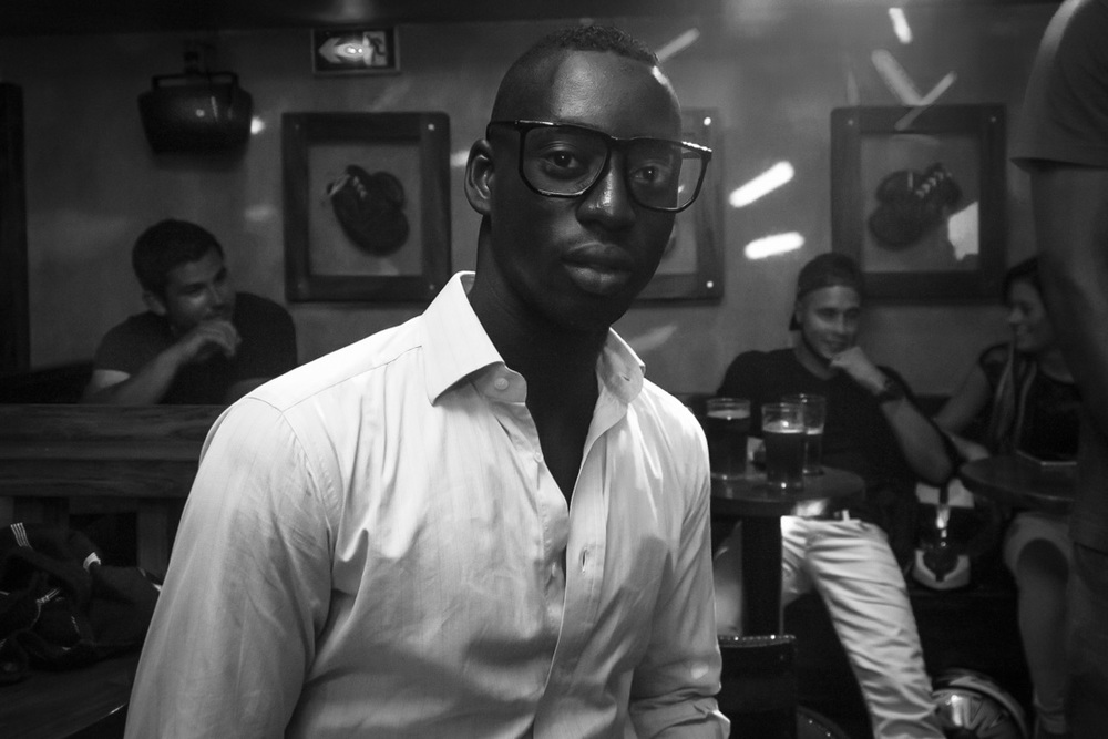 pub clubbing glasses bw black man paris beer white shirt irish party.jpg