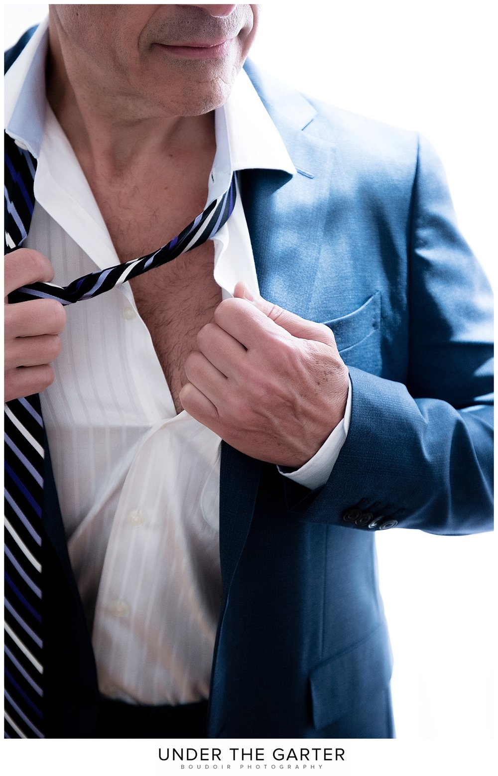 denver dudoir male boudoir photography removing tie.jpg