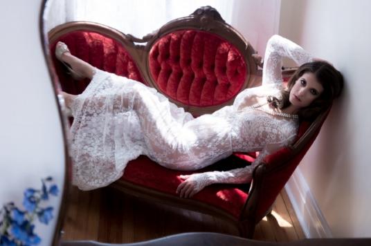 Bridal-Boudoir-Photo-Denver-Woman-in-White-Lace-Dress-on-Red-Velvet-Chaise