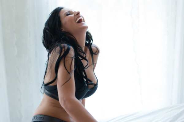 Boudoir Woman Laughs in Lingerie on Bed.jpg