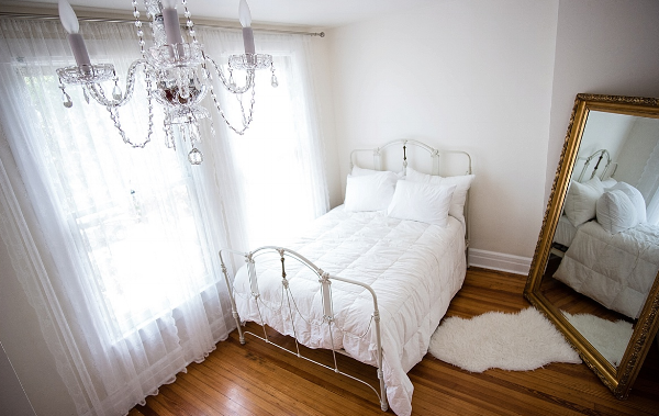 Iron Bed Chandelier and Vintage Floor Mirror.jpg