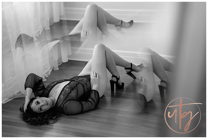 boudoir photography denver sheer bodysuit floor pose.jpg
