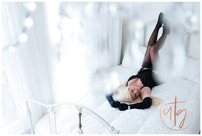 boudoir photography denver bed chandelier.jpg
