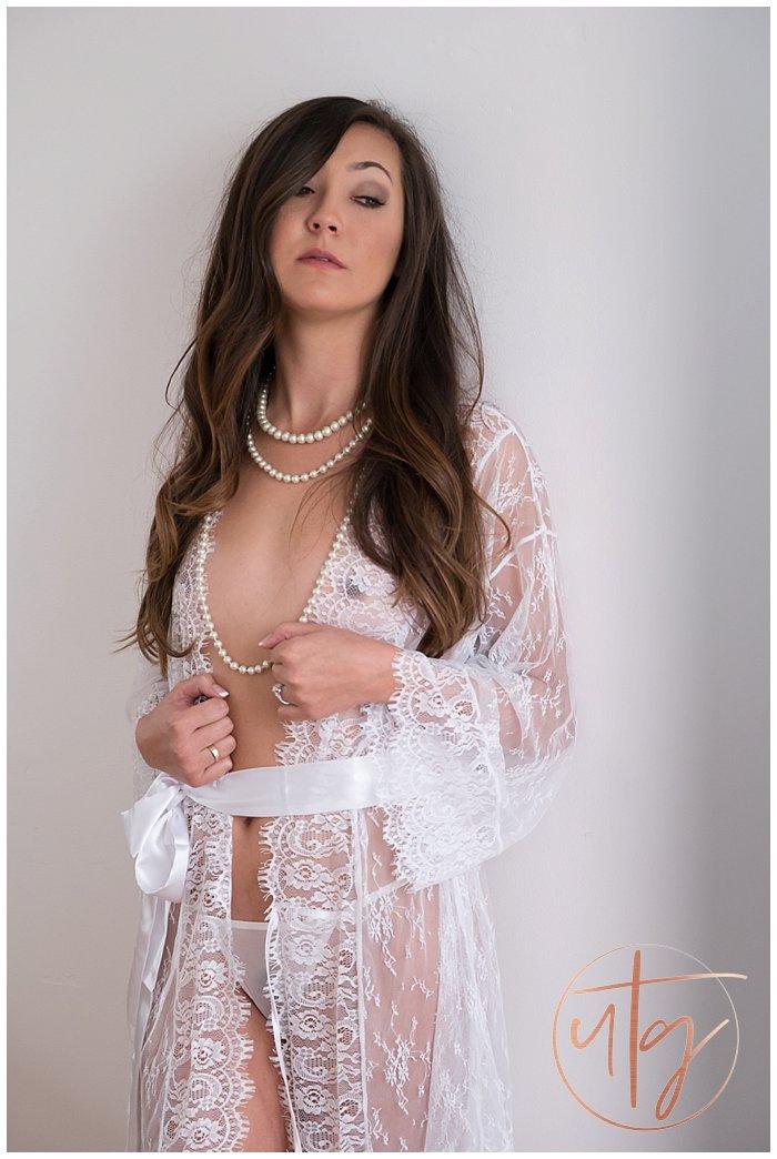 boudoir photography sheer lace pearls long hair.jpg