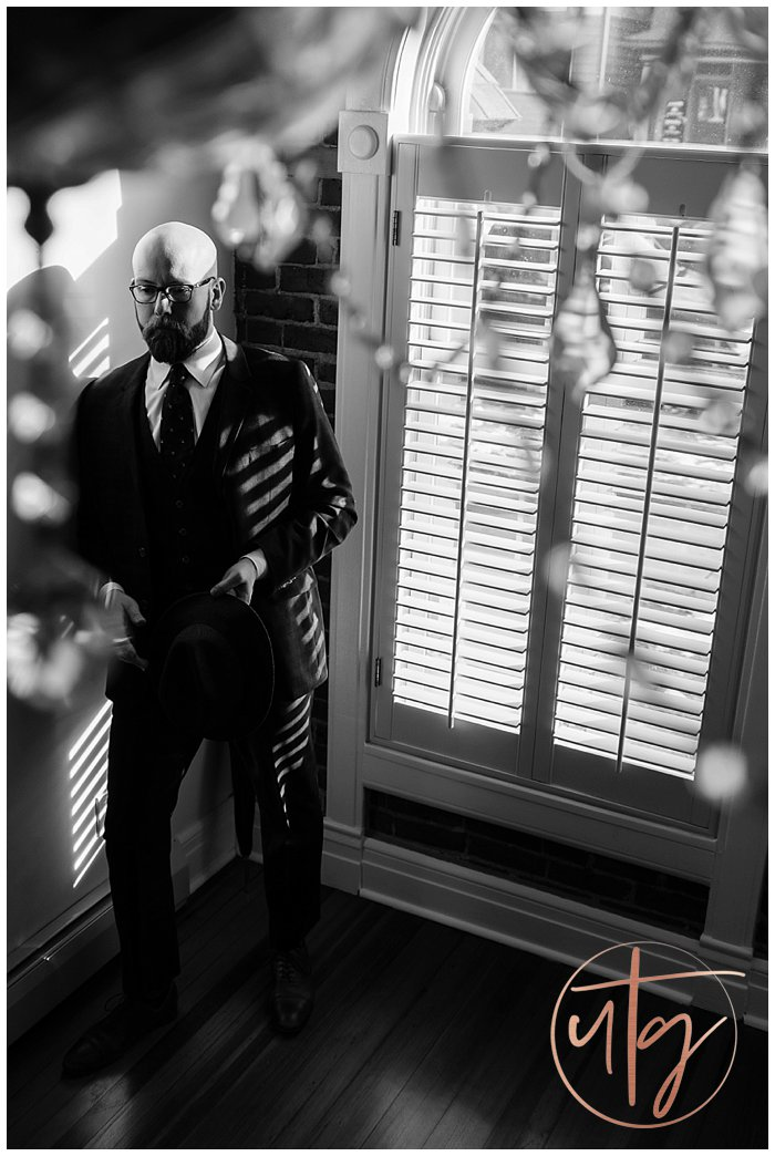 male boudoir photography denver dudoir suit chandelier.jpg
