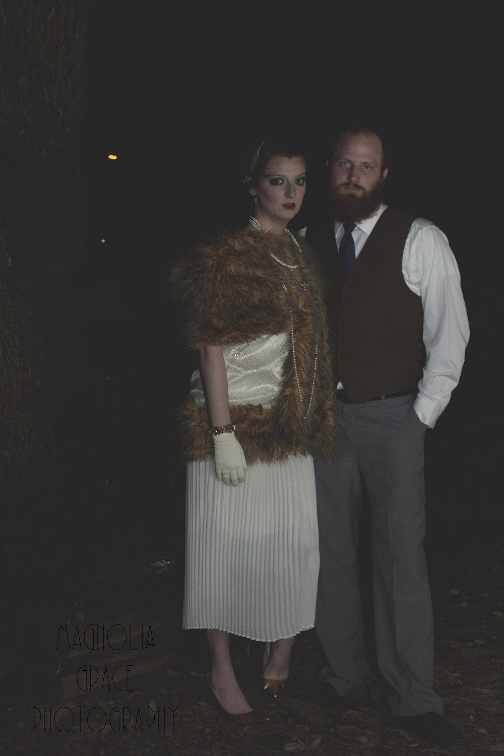 My husband, Trey, and I headed to a 1920's party fundraiser!!! It was SUCH a blast. Also, I added all the fur and the sparkly fabric to the dress. Learning how to sew thanks to my Momma!