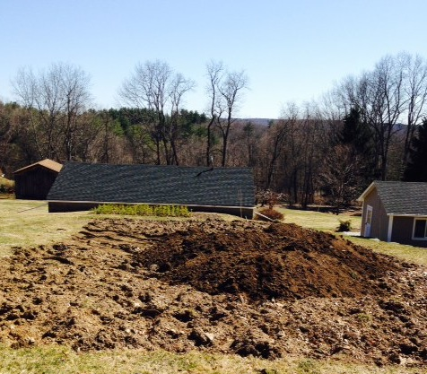 April 6, 2014. Pull back the top soil. Add mulchy-compost cooked over the years from Bob's landscaping activities: fall and spring cleanups. It all gets recycled!