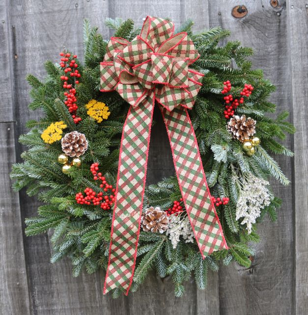 Double-sided wreaths with farm-picked winterberries, dried yarrow/statice, and designer bow, $30.