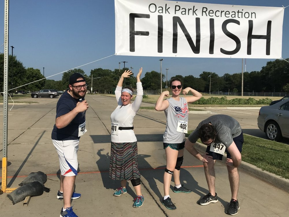 At the finish line. L to R: Daniel, me, Cassandra (also first time 5k-er!), Russ