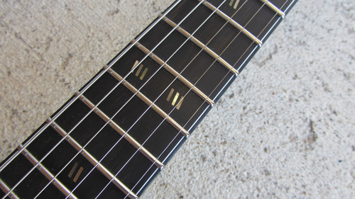 Slash variant inlays (two sets of three slashes at the 12th fret instead of two sets of two slashes)