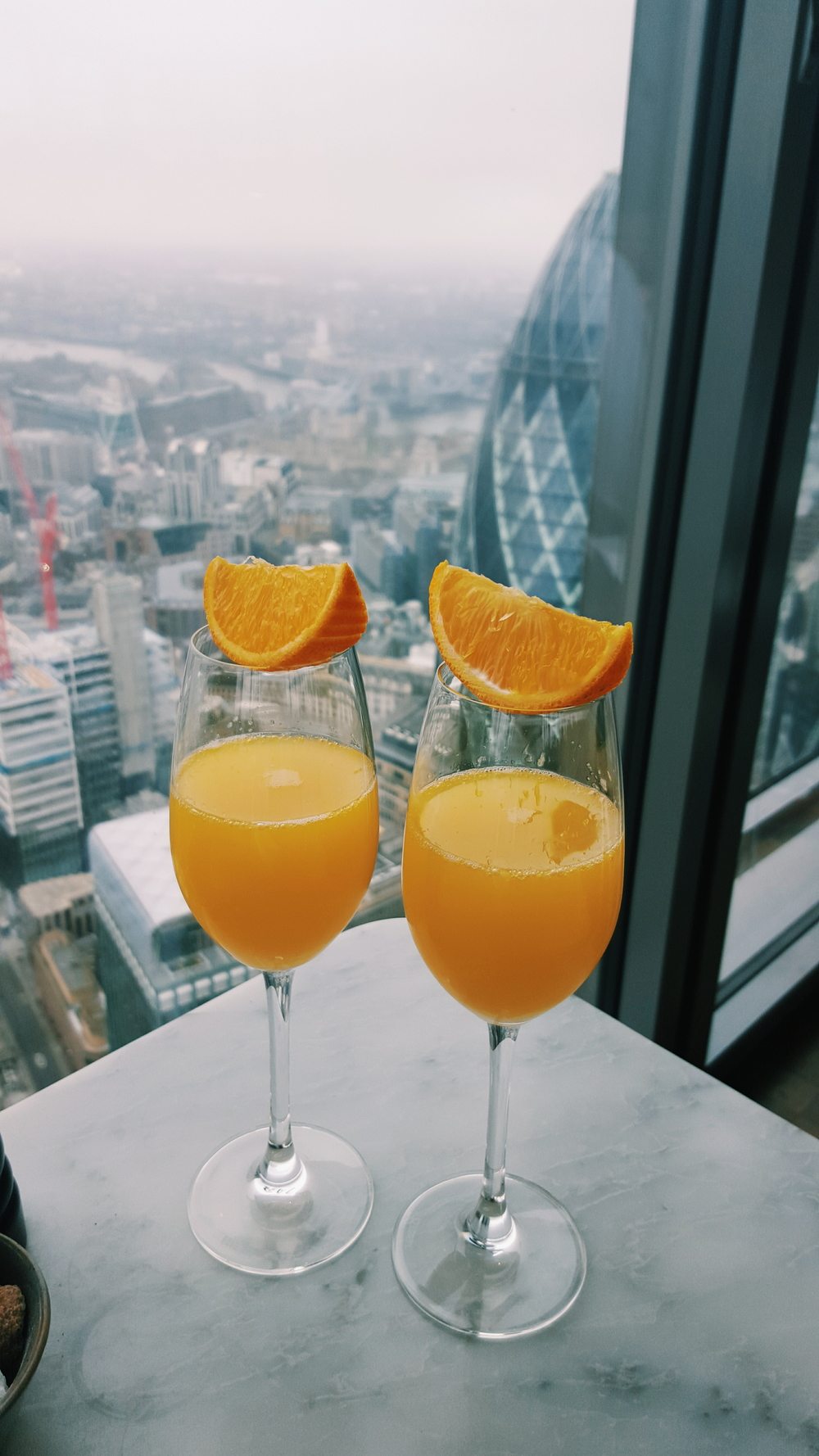 Mimosas with a view at Duck & Waffle