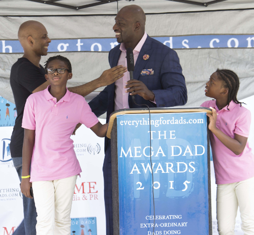 Jim Mckenzie & WWE's Titus O'Neil At The 2015 Daddy & Family Expo