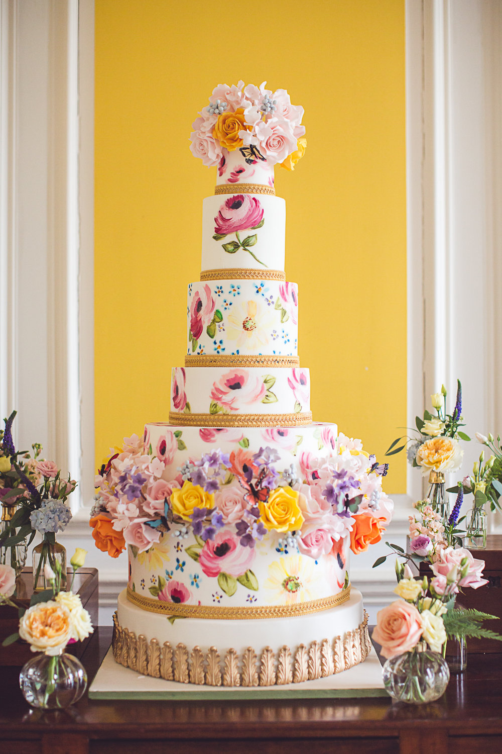Stunning hand painted cakes by Elizabeth's Cake Emporium mingle perfectly with flowers by Indeco Flowers