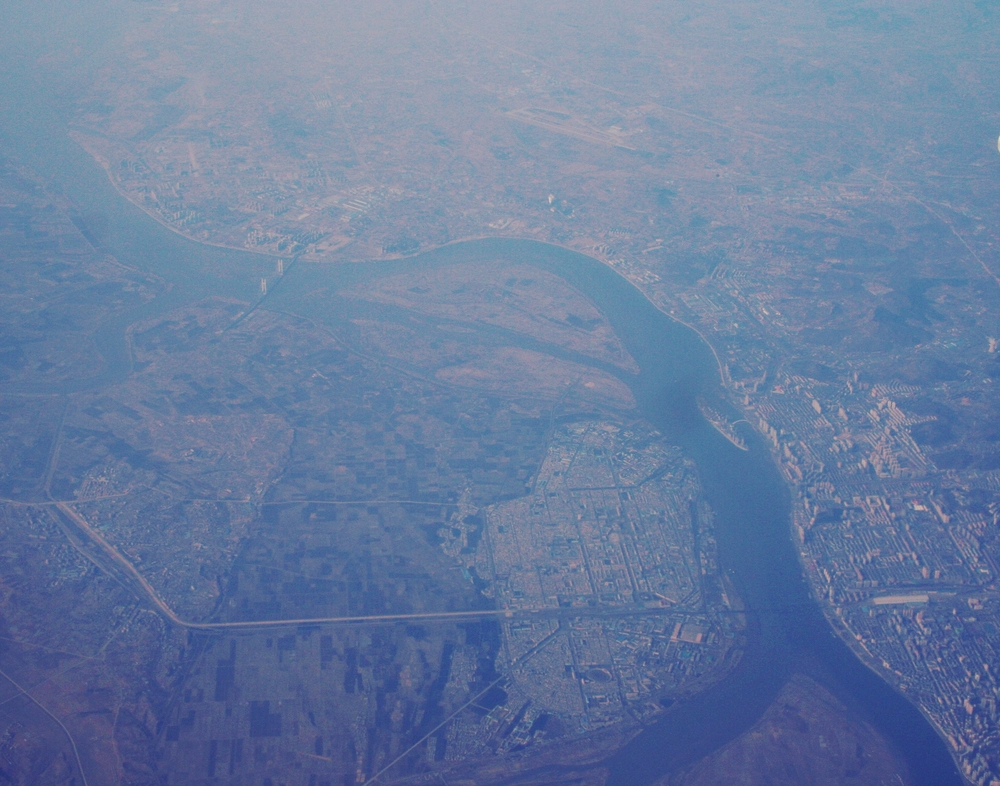 Sinuiju and Dandong, from a comfy Air Koryo window seat.