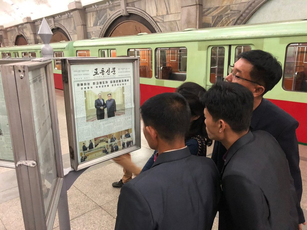 A picture of North Koreans reading about Secretary Pompeo's visit from our volunteer team in Pyongyang in May 2018 running a startup workshop