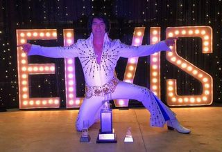 Elvis with sign.jpg