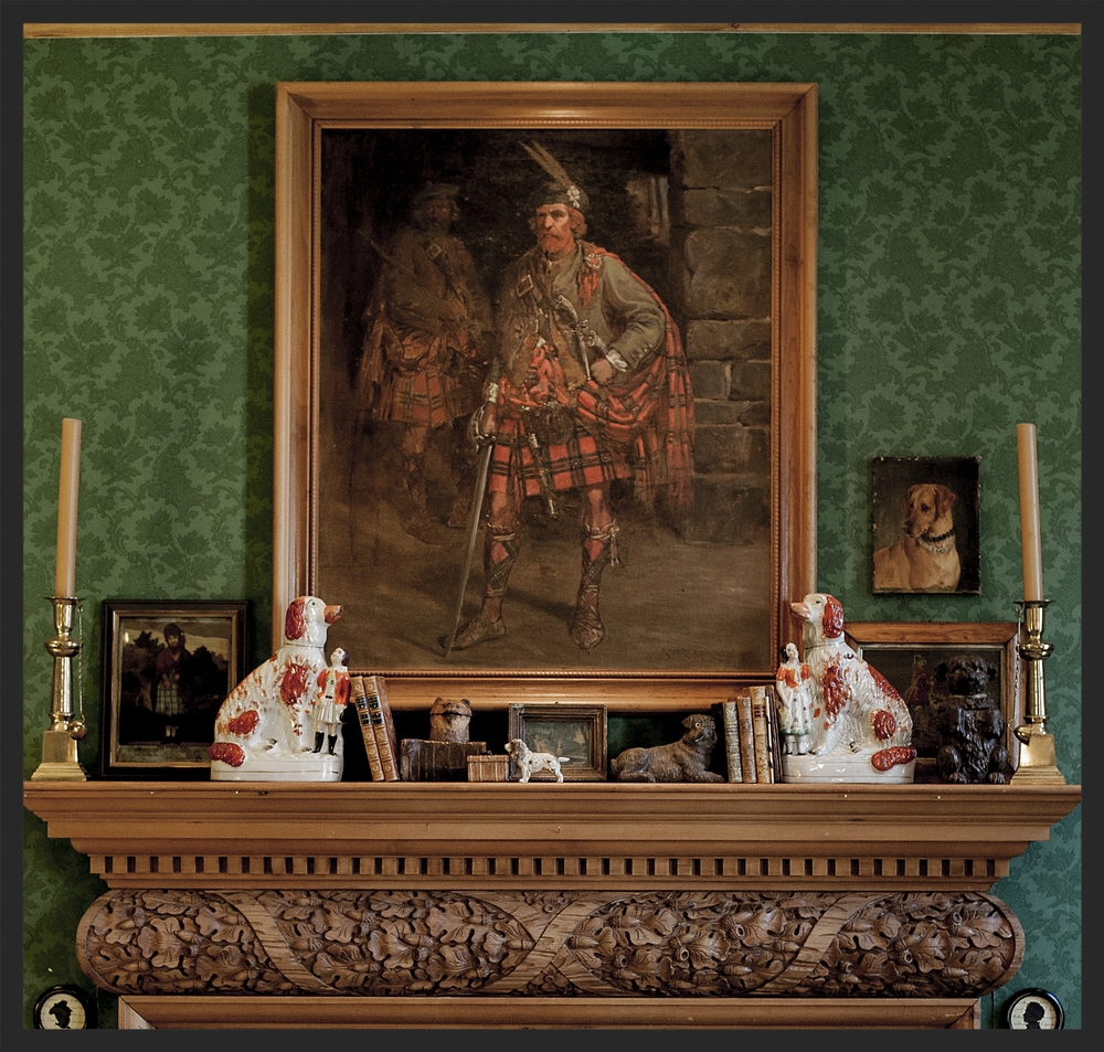 Painting of Rob Roy hangs over the mantle. Various dog relics on the mantle.  Linda Kay McCloy - alittleenglishinteriors.com