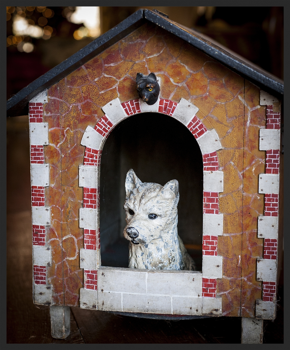 Early painted dog house. Notice the little dog head over the door and the iron Scottie door stop who has taken up residence in the dog house.  Linda Kay McCloy - alittleenglishinteriors.com
